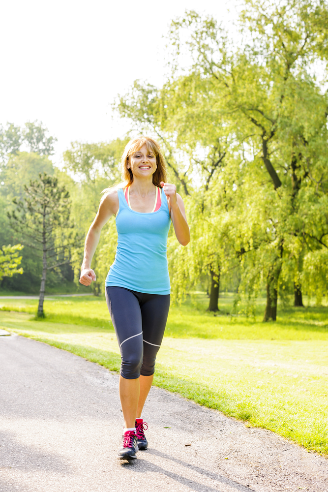 shutterstock_237220609 smling woman jogging Feb15