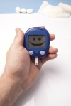 shutterstock_126015788 blood glucose monitor smiley Mar15
