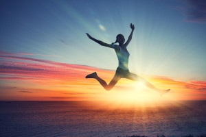 shutterstock_174553253 woman jumping over sunset Mar15