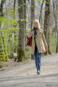 shutterstock_249400753 50+ woman walking in park Apr15