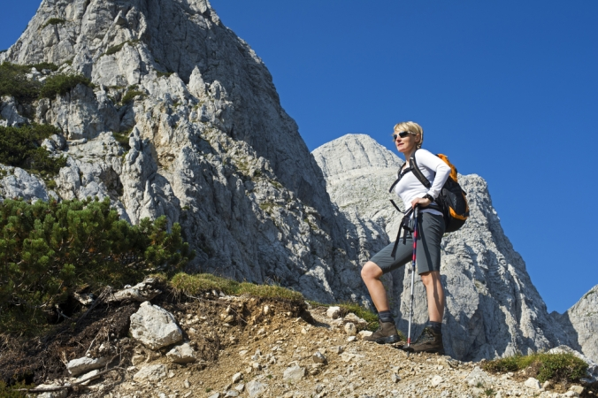 A woman hiking in the mountains