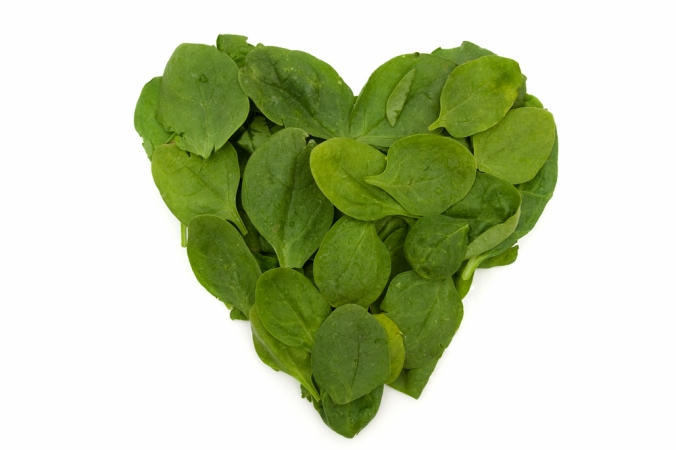 Spinach leaves made into a heart shape