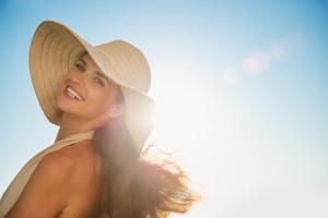 shutterstock_106787477 headshot woman in sun with hat Jun15