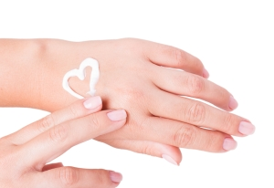 shutterstock_161171273 cream heart on back of hand June15