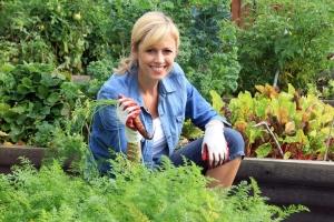 shutterstock_219462244 woman in garden holding carrot July15