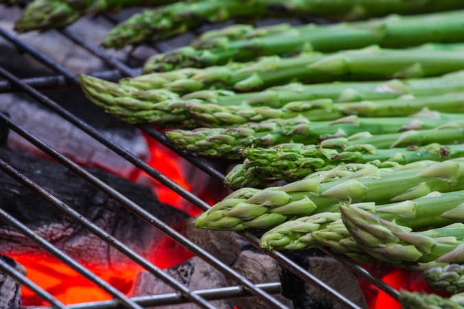 Close up of asparagus being grilled on a bbq
