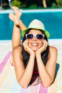 shutterstock_177395282 woman in sun by pool Aug15