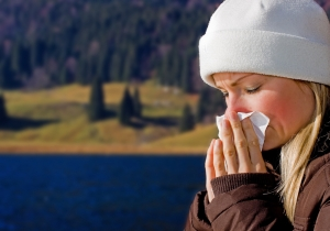 shutterstock_19511227 woman blowing nose with lake background Aug15