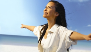 shutterstock_200010890 smiling woman in sunshine Aug15