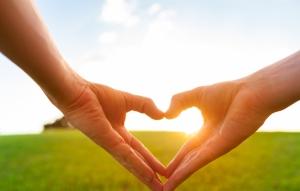 shutterstock_244939462 hands making a heart around sunshine Aug15