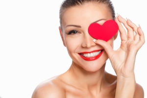 shutterstock_169249814 woman with heart over eye Sept15