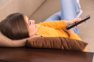 shutterstock_194915099 woman watching TV Sept15
