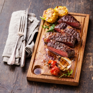 shutterstock_236232739 steak on wooden board Sept15