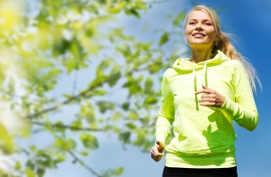 shutterstock_249902236 woman running and smiling Sept15