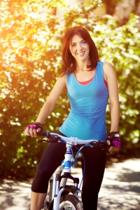 shutterstock_253853761 woman on bike Sept15
