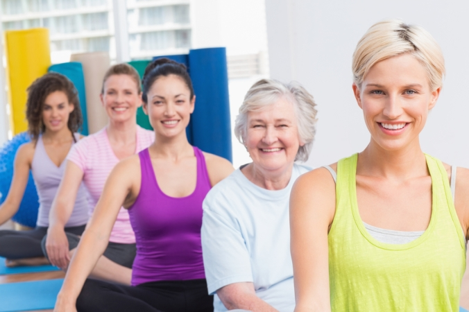 group of women of varying ages in a yoga class