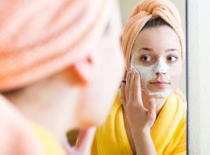 shutterstock_287082125 woman with face pack Oct15
