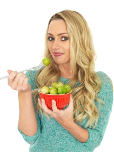 shutterstock_237478318 woman with sprouts Nov15