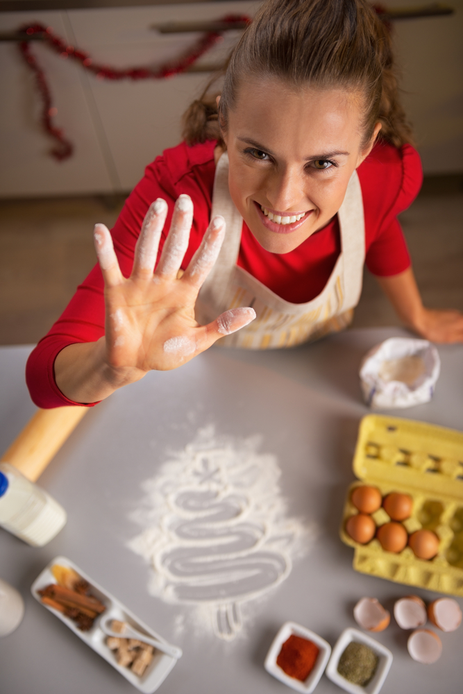 shutterstock_232325464 woman in kitchen christmas flour tree Dec15