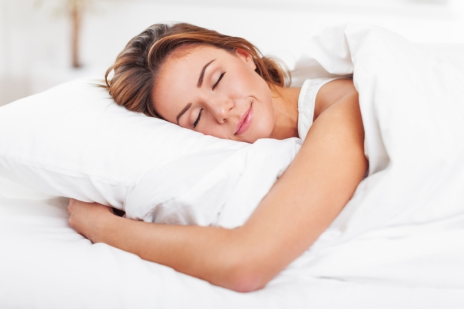 shutterstock_294386738 woman sleeping in bed Jan16