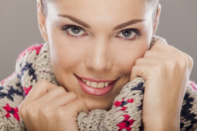 Close up of woman smiling in a cosy jumper