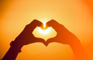 shutterstock_205649467 heart with hands sun Feb16