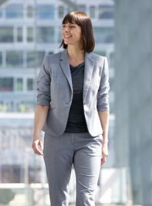 shutterstock_292441592 business woman walking in town Nov15