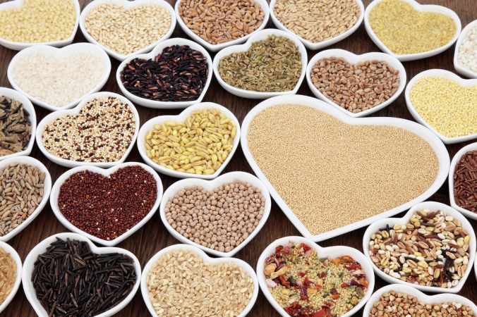 A range of wholegrains in heart shaped dishes to show they are good for the heart