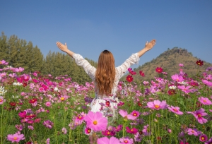 shutterstock_360808592 woman in flower field Apr16