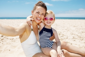 shutterstock_405426820 mum and child on beach May16