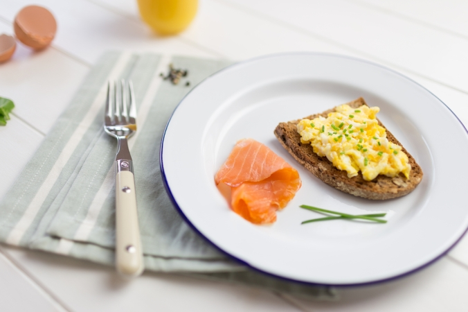 Scrambled eggs on toast with a side of smoked salmon
