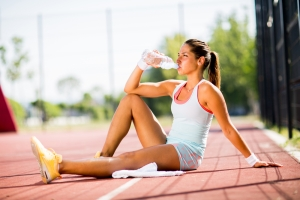 shutterstock_284081948 woman exercising drinking water June16