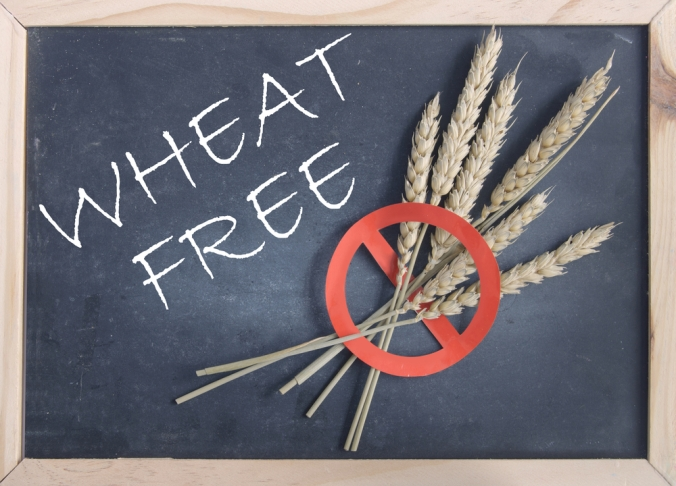 A blackboard with the words wheat free written on next to some wheat