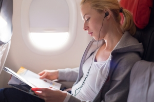 shutterstock_402029926 woman relaxing on plane flight July16