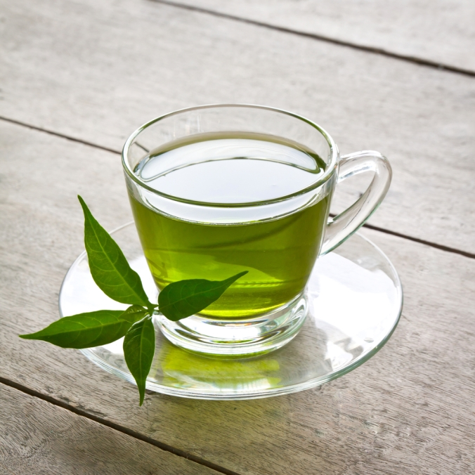 A glass tea cup of green tea