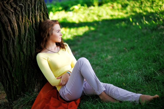 shutterstock_407642230 woman relaxing outside Aug16