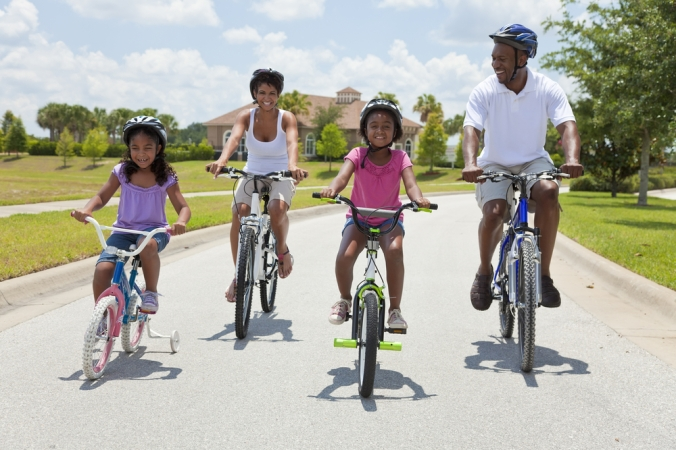 A family going for a bike ride