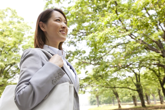 shutterstock_180940427 business woman walking park Sept16