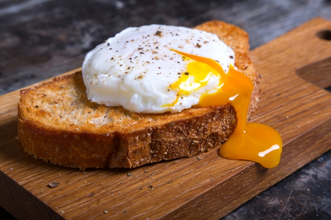 Poached egg on brown toast