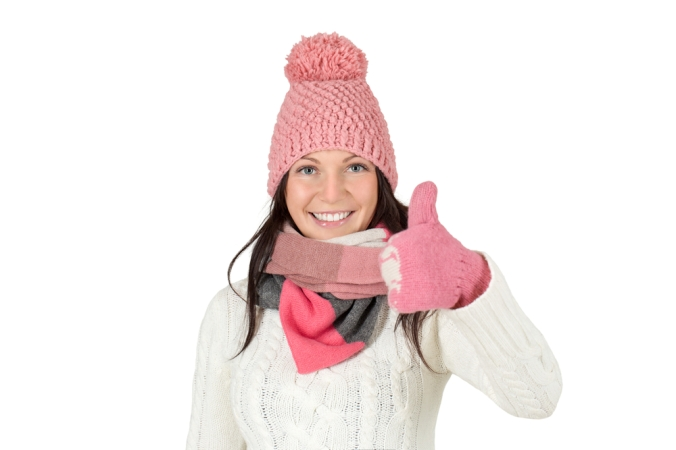 shutterstock_236940868-woman-winter-hat-gloves-thumbs-up-oct16