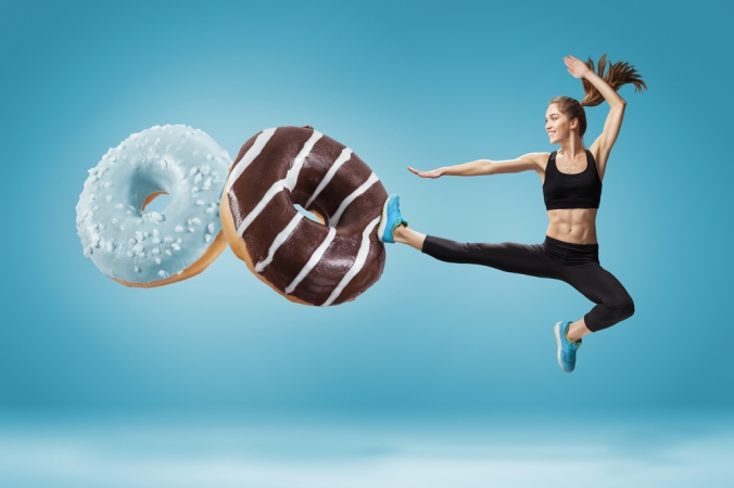 A woman kicking away donuts to represent cutting out junk food