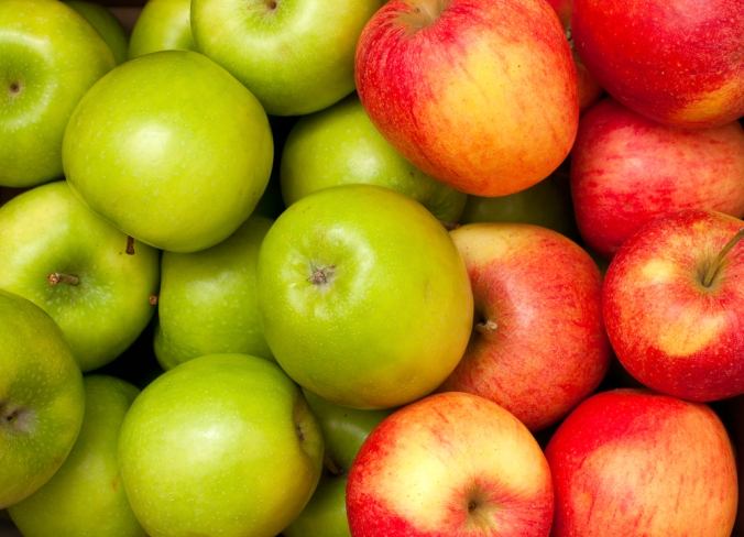 a selection of green and red apples