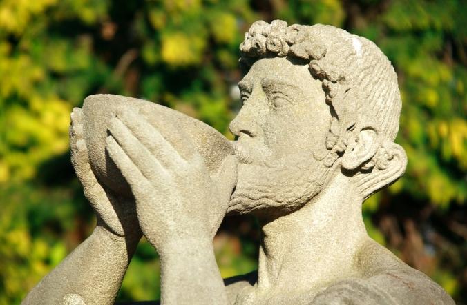 shutterstock_435013849-roman-statue-drinking-nov16
