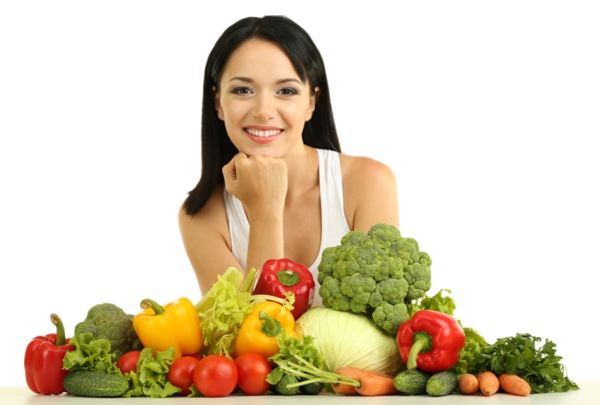 shutterstock_142396240-woman-with-pile-of-veg-jan17