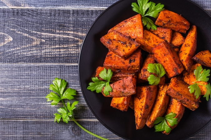 A bowl of roasted sweet potato wedges