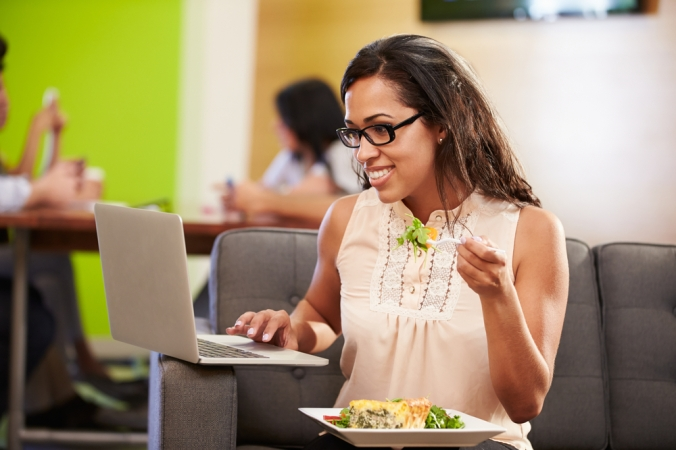 shutterstock_244609228-woman-eating-lunch-at-desk-work-feb17
