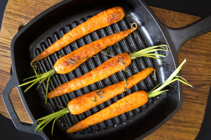 Carrots being cooked on a griddle pan