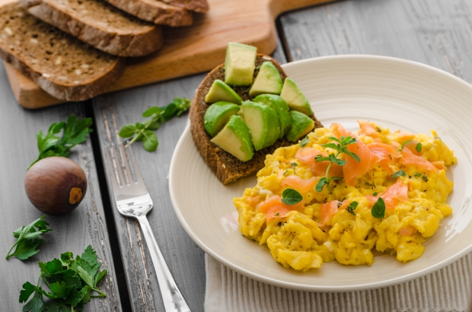 A healthy breakfast of eggs, smoked salmon and avocado
