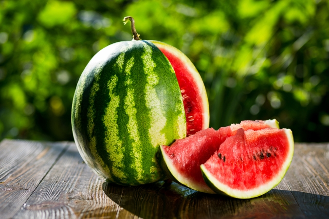 Whole watermelon and slices of watermelon