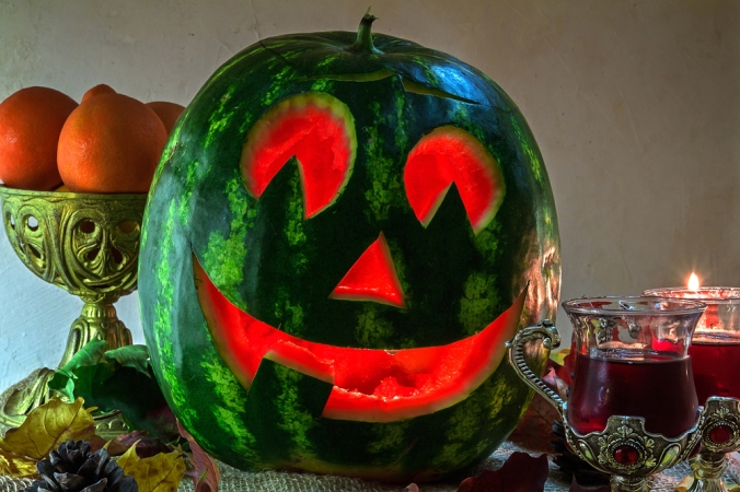 A Halloween jack o lantern carved out of a watermelon